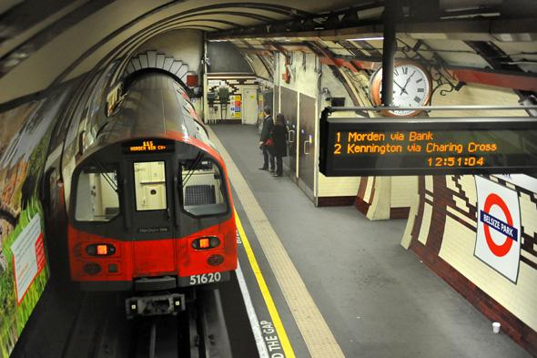 A Northern Line tube train leaves Belsize Park Underground station in London.