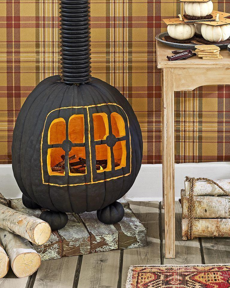 """<p>Replicate the look of a roaring, wood-burning stove on your front porch—using the glow of a bright orange pumpkin! This rustic idea will have all the neighbors talking about your fun and festive display. </p><p><strong>See more at <a href=""""https://www.countryliving.com/diy-crafts/g1350/pumpkin-decorating-1009/?slide=58"""" rel=""""nofollow noopener"""" target=""""_blank"""" data-ylk=""""slk:Country Living"""" class=""""link rapid-noclick-resp"""">Country Living</a>. </strong></p><p><strong><a class=""""link rapid-noclick-resp"""" href=""""https://www.amazon.com/Battery-Operated-Tea-Lights-Candles/dp/B08L7SBC1T/ref=sr_1_5?tag=syn-yahoo-20&ascsubtag=%5Bartid%7C2164.g.36877187%5Bsrc%7Cyahoo-us"""" rel=""""nofollow noopener"""" target=""""_blank"""" data-ylk=""""slk:SHOP TEA LIGHTS"""">SHOP TEA LIGHTS</a><br></strong></p>"""