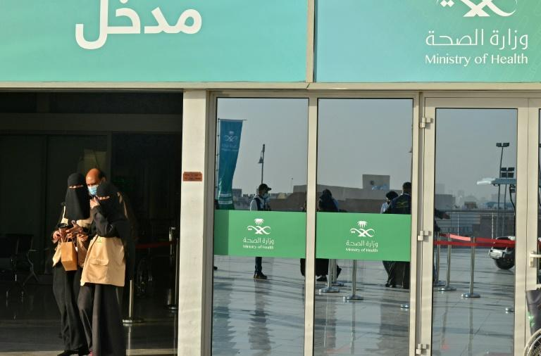 In this file photo from January 21, 2021, people leave the Riyadh International Convention and Exhibition Center in the Saudi capital after being vaccinated against Covid-19