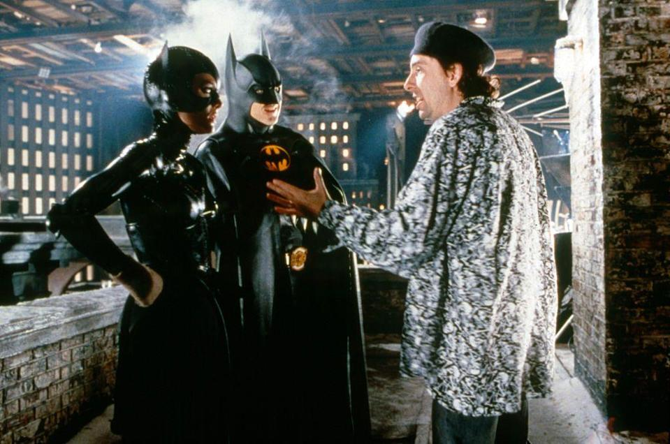 """<p>Michelle Pfeiffer and Michael Keaton get direction from director Tim Burton on the set of Batman Returns. Keaton was reportedly against Pfeiffer being cast in the movie, as <a href=""""https://www.hollywoodreporter.com/heat-vision/batman-michael-keaton-vetoed-michelle-pfeiffer-role-1989-film-1220139"""" rel=""""nofollow noopener"""" target=""""_blank"""" data-ylk=""""slk:they had previously dated"""" class=""""link rapid-noclick-resp"""">they had previously dated</a>.</p>"""