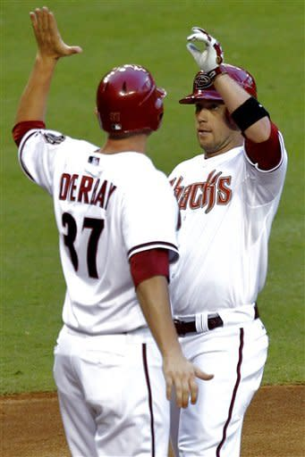 Arizona Diamondbacks' Aaron Hill high-fives Lyle Overbay after hitting a two-run home run against the Colorado Rockies during the second inning of a baseball game, Tuesday, June 5, 2012, in Phoenix. (AP Photo/Matt York)
