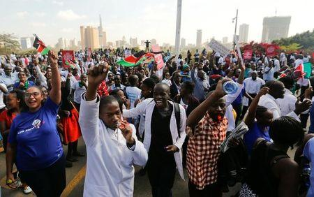 Kenyan doctors chant slogans to demand fulfilment of a 2013 agreement between their union and the government that would raise their pay and improve working conditions outside the employment and labour relations courts in Nairobi