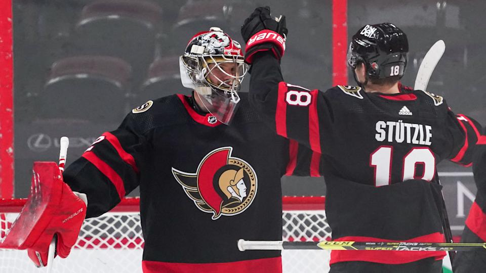 OTTAWA, ON - MARCH 22:  Making his NHL debut as a starting goaltender, Filip Gustavsson #32 of the Ottawa Senators celebrates his first career NHL win against the Calgary Flames with teammate Tim Stützle #18 at Canadian Tire Centre on March 22, 2021 in Ottawa, Ontario, Canada.  (Photo by Andre Ringuette/NHLI via Getty Images)