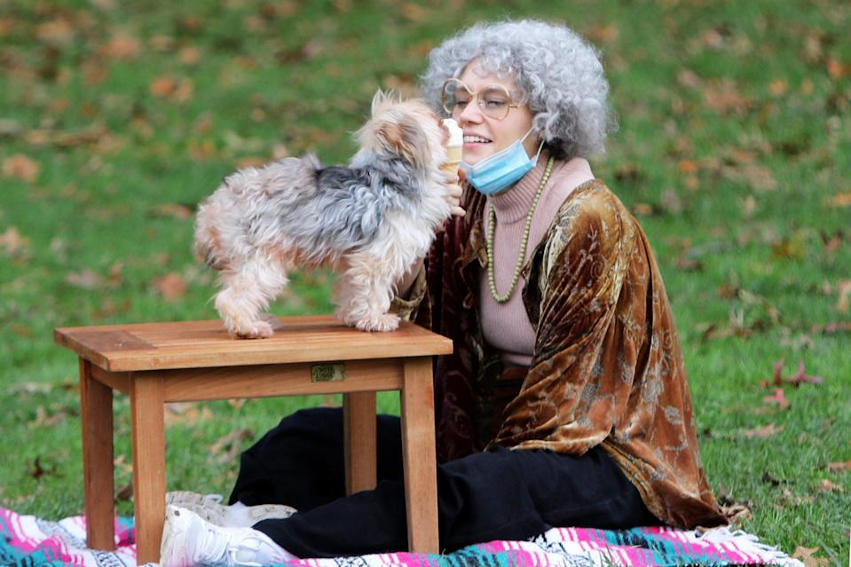 <p>Kate McKinnon wears a grey wig and feeds ice cream to a furry friend while filming a skit for<i> Saturday Night Live</i> on Tuesday in N.Y.C. </p>