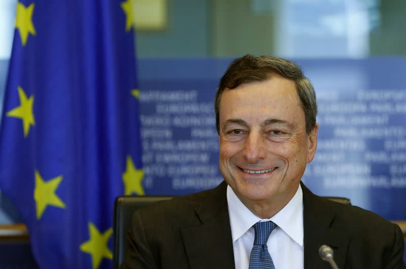 European Central Bank President Mario Draghi smiles at the start of a meeting of the European Parliament's Economic and Monetary Affairs Committee in Brussels
