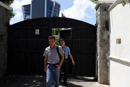 Taiwan nationals leave the Taiwan embassy a day after the Salvadoran government announced that it has broken off diplomatic relations with Taiwan, in San Salvador, El Salvador August 21, 2018. REUTERS/Jose Cabezas