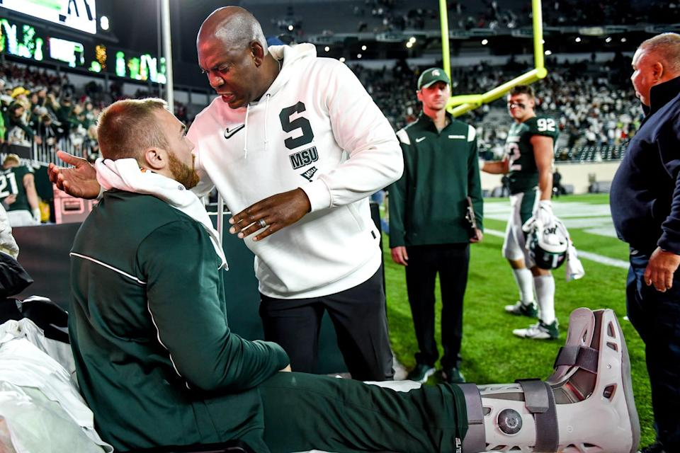 Michigan State head coach Mel Tucker, right, hugs Drew Beesley after beating Nebraska in overtime on Saturday, Sept. 25, 2021, at Spartan Stadium in East Lansing. Beesley injured his right leg in the first half.