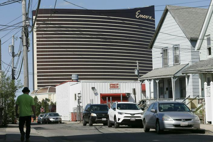 FILE - In this May 22, 2019 file photo, Encore Boston Harbor casino looms above the surrounding neighborhood in Everett, Mass. The casino is scheduled to open on Sunday, June 23. (AP Photo/Michael Dwyer, File)