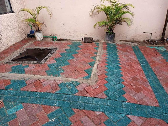 Different shades of Nzambi Matee's recycled bricks adorn this Kenyan patio/courtyard.