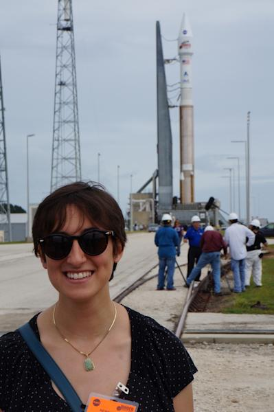 SPACE.com reporter Miriam Kramer stands in front of the Atlas 5 rocket housing the MAVEN probe on the launch pad in Florida. Photo released Nov. 16, 2013.