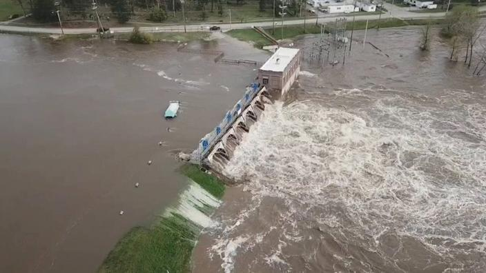 The Sanford Dam breached on Tuesday after days of heavy rain