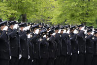 Police officers line the street as the funeral procession of New York police officer Anastasios Tsakos leaves the St. Paraskevi Greek Orthodox Shrine Church, Tuesday, May 4, 2021, in Greenlawn, N.Y. Tsakos was at the scene of an accident on the Long Island Expressway when he was struck and killed by an allegedly drunk driver a week ago. (AP Photo/Mark Lennihan)
