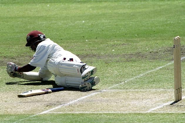 16 Dec 2000:  Brian Lara of West Indies takes evasive action from a swarm of bees during  the second  days play of the Third Test match at the Adelaide Oval in Adelaide, Australia. Credit: Hamish Blair/ALLSPORT