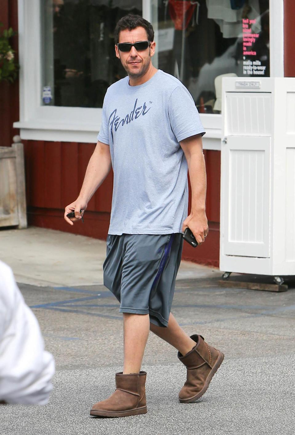 <p>Who can blame Sandler for sporting Uggs? They're like wearing clouds on your feet! (Photo: SMXRF/Star Max/GC Images)</p>