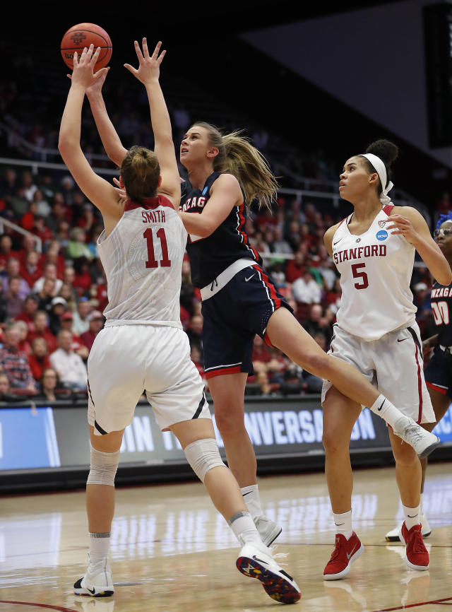 Gonzaga forward Jill Barta, center, takes a shot over Stanford forward Alanna Smith (11) during the first half of a first-round game in the NCAA women's college basketball tournament in Stanford, Calif., Saturday, March 17, 2018. (AP Photo/Tony Avelar)