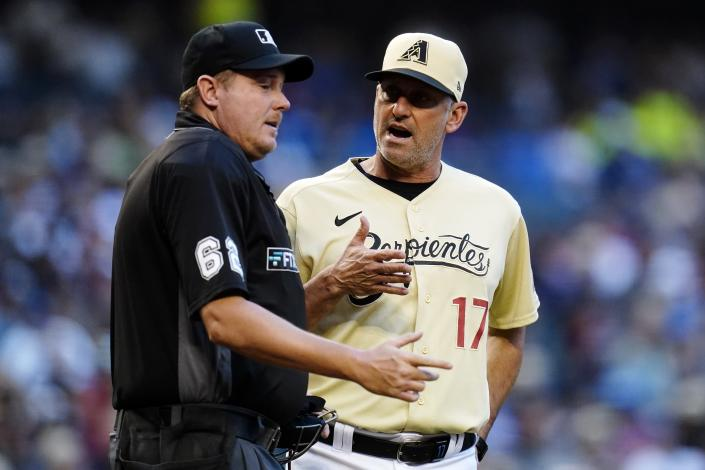Arizona Diamondbacks manager Torey Lovullo (17) argues with umpire Chad Whitson, left, during the third inning of a baseball game against the Los Angeles Dodgers Saturday, Sept. 25, 2021, in Phoenix. (AP Photo/Ross D. Franklin)