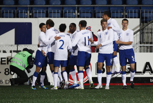 England national Under-21 football team celebrate its victory against Norway at the end of the U21 European Championship qualifying football match at the Marienlyst stadium in Drammen on October 10, 2011. England won the match 2-1. AFP PHOTO/ SCANPIX/ TROND REIDAR TEIGEN ***NORWAY OUT*** (Photo credit should read Trond Reidar Teigen/AFP/Getty Images)