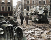 <p>A police officer and soldier inspect the aftermath of a devastating air raid on Portman Street in Marylebone, Central London. (MediaDrumWorld) </p>