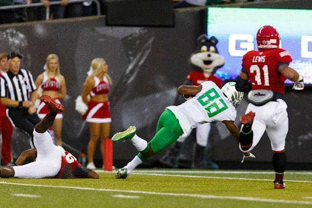 Oregon wide receiver Dwayne Stanford (88) dives into the end zone for a touchdown during the first quarter against South Dakota in an NCAA college football game in Eugene, Ore., Saturday, Aug. 30, 2014. (AP Photo/Ryan Kang)