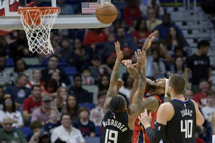 New Orleans Pelicans forward Brandon Ingram (14) shoots against Los Angeles Clippers guard Rodney McGruder (19) in the first half an NBA basketball game in New Orleans, Saturday, Jan. 18, 2020. (AP Photo/Matthew Hinton)