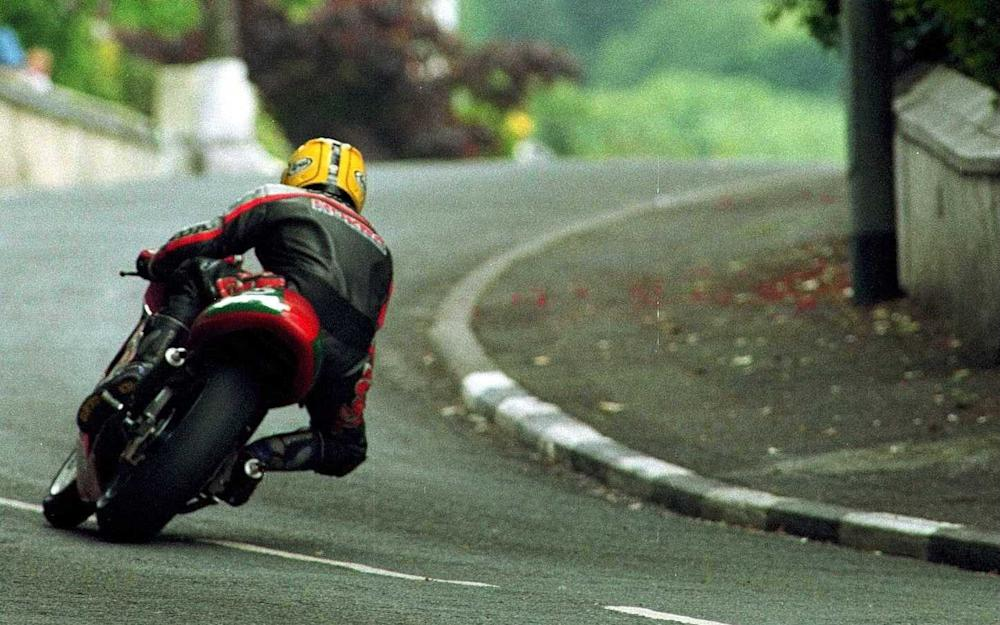 Manx TT...5 May 2000: Joey Dunlop of Northern Ireland in action at May Hill, in the lead, on his final lap during the Lightweight 250cc class race. Mandatory Credit: Ian Walton/ALLSPORT - Credit: IAN WALTON/Getty