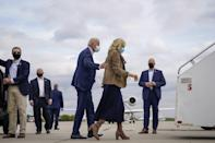 <p>Back in October 2020, Dr. Biden boarded the campaign plane in Philadelphia wearing a navy midi dress that revealed just the right amount of boot, coordinated with a matching suede camel blazer and graphic-printed scarf.</p>