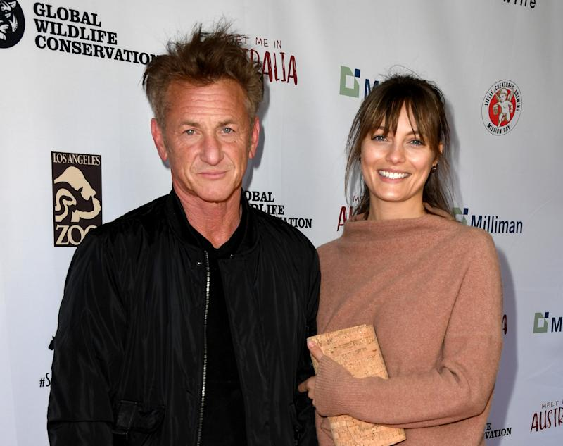 "LOS ANGELES, CALIFORNIA - MARCH 08: Sean Penn (L) and Leila George arrive at the ""Meet Me In Australia"" event benefiting Australia Wildfire Relief Efforts at Los Angeles Zoo on March 08, 2020 in Los Angeles, California. (Photo by Kevin Winter/Getty Images)"