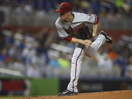 Arizona Diamondback starting pitcher Chase Anderson throws to the Miami Marlins during the first inning of a baseball game in Miami, Thursday, Aug. 14, 2014. (AP Photo/J Pat Carter)