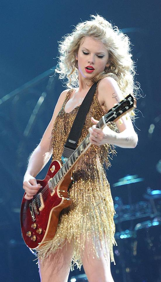 """Crossover cutie Taylor Swift confessed on """"Late Night With Jimmy Fallon"""" that she learned to play her first guitar chords from a computer repairman at the tender age of 10. Flash forward 11 years, and the """"Teardrops on My Guitar"""" songstress, 21, is one of the hottest acts around. Rick Diamond/<a href=""""http://www.gettyimages.com/"""" target=""""new"""">GettyImages.com</a> - May 21, 2011"""