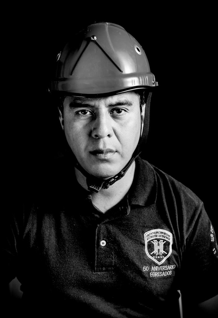 <p>Miguel Angel Sesma, a 40-year-old bachelor of public safety who volunteered in the integral risk management after the 7.1 earthquake hitted Central Mexico on Sept. 19, poses in Mexico City on Sept. 25, 2017. (Photo: Omar Torres/AFP/Getty Images) </p>