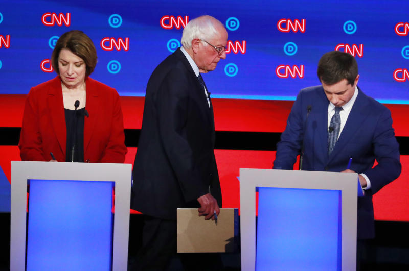 U.S. Senator Amy Klobuchar, U.S. Senator Bernie Sanders and South Bend Mayor Pete Buttigieg (R) pause during a commercial break on the first night of the second 2020 Democratic U.S. presidential debate in Detroit, Michigan, U.S., July 30, 2019. REUTERS/Lucas Jackson