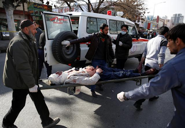<p>People carry an injured man to a hospital after a blast in Kabul, Afghanistan, Jan. 27, 2018. (Photo: Mohammad Ismail/Reuters) </p>