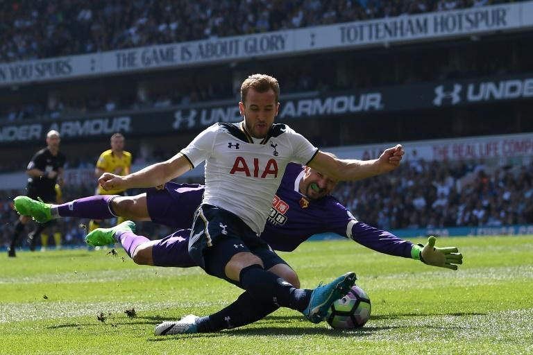 Tottenham Hotspur's Harry Kane shoots past Watford's goalkeeper Heurelho Gomes but fails to score during their English Premier League match, at White Hart Lane in London, on April 8, 2017