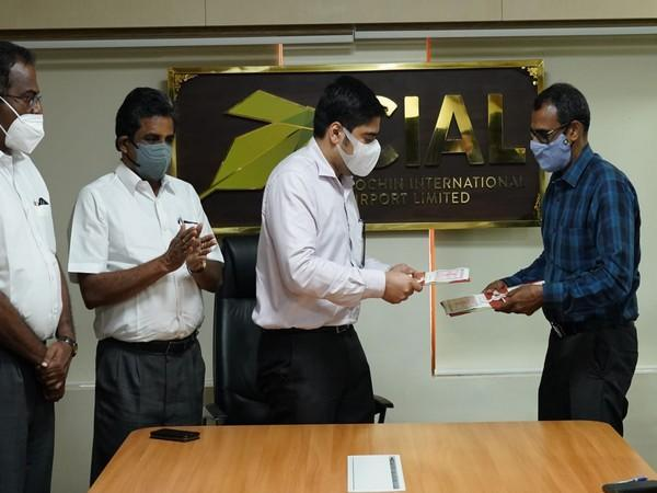 CIAL Managing Director S Suhas IAS and Muziris Heritage Project Ltd Managing Director PM Nowshad exchange the MOU papers at a function held at Kochi airport.