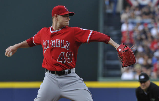 Los Angeles Angels starting pitcher Garrett Richards (43) holds Atlanta Braves' B.J. Upton on first base during the first inning of a baseball game on Saturday, June 14, 2014, in Atlanta. (AP Photo/David Tulis)
