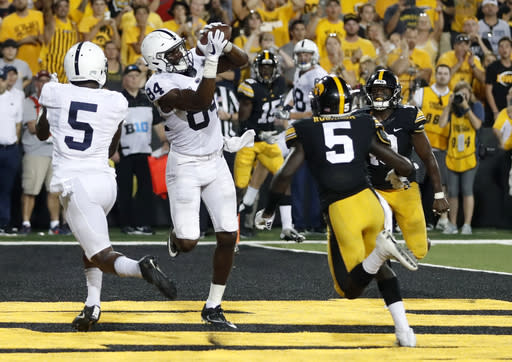 "Penn State wide receiver <a class=""link rapid-noclick-resp"" href=""/ncaaf/players/257348/"" data-ylk=""slk:Juwan Johnson"">Juwan Johnson</a> (84) catches a touchdown pass between teammate DaeSean Hamilton, left, and Iowa defensive backs Manny Rugamba and Miles Taylor, right, as time expires in an NCAA college football game Saturday, Sept. 23, 2017, in Iowa City, Iowa. (AP Photo/Jeff Roberson)"
