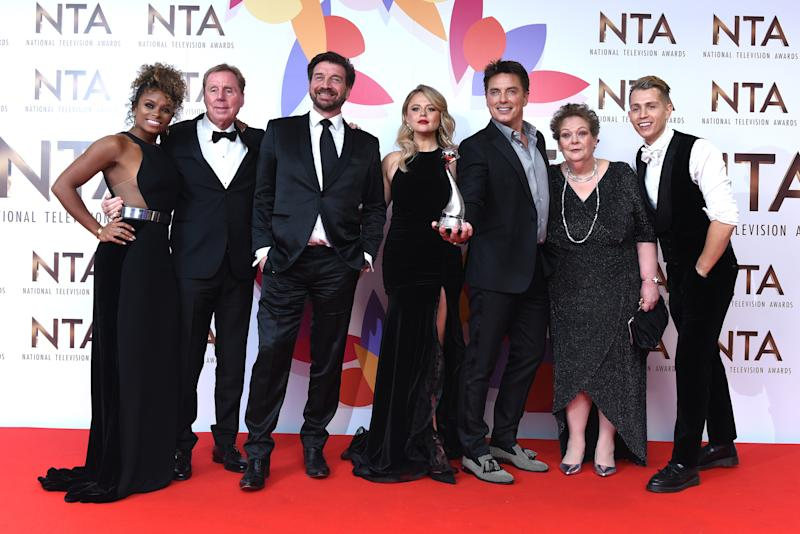 Fleur East, Harry Redknapp, Nick Knowles, Emily Atack, John Barrowman, Anne Hegerty, James McVey and Scarlett Moffatt pose with The Bruce Forsyth Entertainment Award for I'm A Celebrity… Get Me Out Of Here! in the winners room during the National Television Awards held at The O2 Arena on January 22, 2019 in London, England. (Photo by Joe Maher/WireImage)