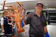 Australian fisherman Joe Paratore displays his catch of the day to customers at the harbour in Fremantle