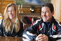 In this photo taken on Monday, Jan. 27, 2014, cross-country skiers Gary and Angelica di Silvestri smile during an interview at the Yellowstone Club in Big Sky, Mont. The American-born man and his Italian-born wife will be representing the tiny Caribbean island nation of Dominica at the Winter Olympics in Sochi next month. The former finance professionals, granted Dominica citizenship for their philanthropic work on the island, are finishing their training in Montana while hastily arranging their own visas, travel logistics and footing the bill for the entire expedition. (AP Photo/Janie Osborne)