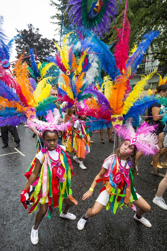 <p>Young performers take part in the Notting Hill Carnival on August 28, 2016 in London, England. The Notting Hill Carnival, which has taken place annually since 1964, is expected to attract over a million people. The two-day event, started by members of the Afro-Caribbean community, sees costumed performers take to the streets in a parade and dozens of sound systems set up around the Notting Hill streets. (Photo by Jack Taylor/Getty Images) </p>