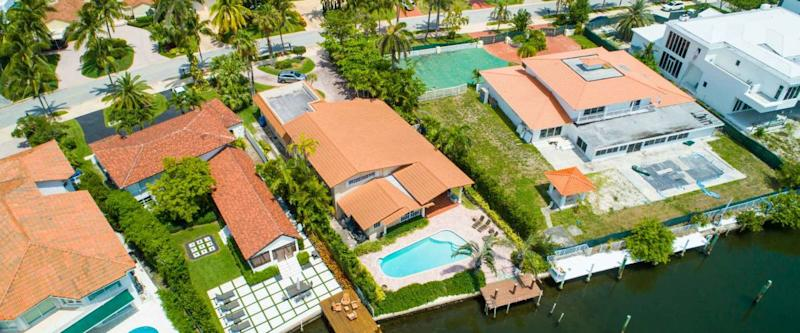 Aerial drone image of waterfront Miami Beach homes on the water