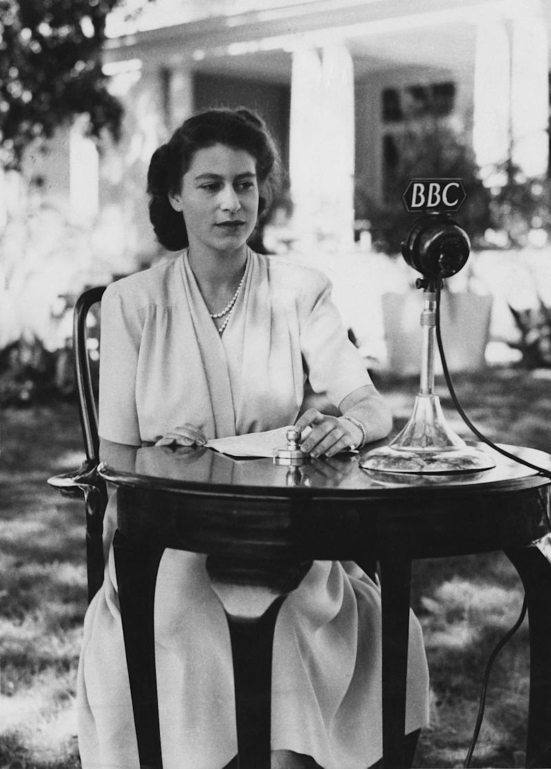 The then Princess Elizabeth makes a broadcast from the gardens of Government House in Cape Town, South Africa, on her 21st birthday, 21 April 1947.