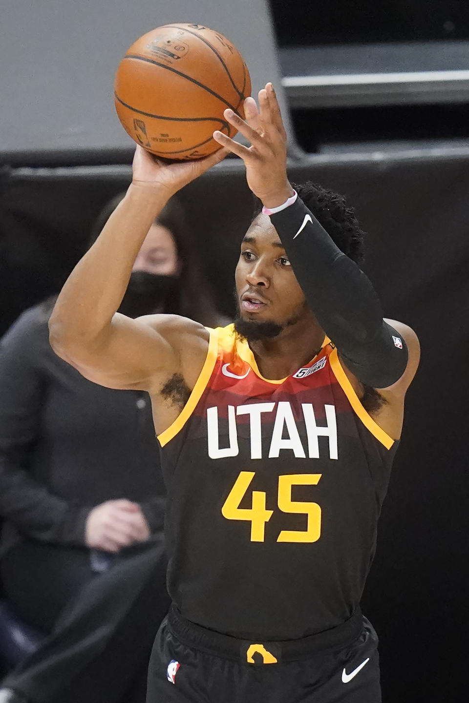 Utah Jazz guard Donovan Mitchell (45) shoots a three-point basket against the Orlando Magic in the first half during an NBA basketball game Saturday, April 3, 2021, in Salt Lake City. (AP Photo/Rick Bowmer)