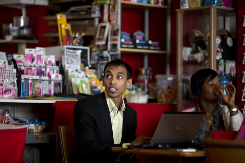 "Britain High Street Lows** Entrepreneur Rafi Akbar, left, teaches a training workshop helping small business entrepreneurs to build self-managed websites at the Greenwich Communication Centre internet cafe on Trafalgar Road in Greenwich, London, Tuesday, March 5, 2013. The small shopkeepers in Greenwich are running out of time. In the London borough that gave its name to Greenwich Mean Time, businesses like Lorraine Turton's are in danger of being relegated to history _ the victims of online shopping, changing tastes and, increasingly, the protracted recession. Her Internet cafe on Trafalgar Road is a rare hive of activity on a ""high street"" _ the British name for a town's main business district. (AP Photo/Matt Dunham)"