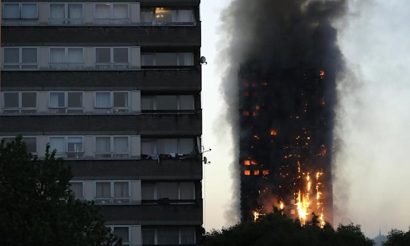 Smoke and flames rise from the Grenfell Tower building in London.