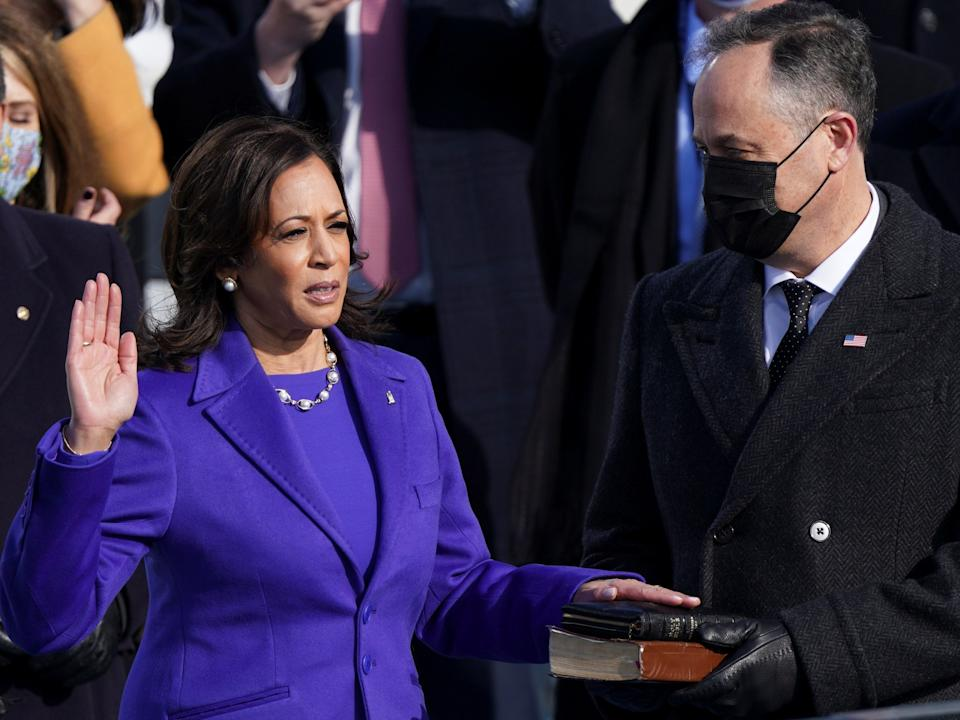 Kamala Harris is sworn in as vice president, becoming the first woman to hold the office in the nation's history, as well as the first Black woman and first woman of South Asian descent to hold the title. Spouse Doug Emhoff holds the bible and also makes history in becoming the first-ever second gentlemanREUTERS