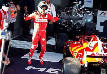 Formula One - F1 - Australian Grand Prix - Melbourne, Australia - 26/03/2017 - Ferrari driver Sebastian Vettel of Germany celebrates after winning the Australian Grand Prix. REUTERS/Brandon Malone