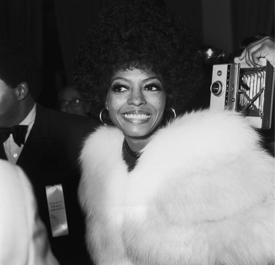 <p>Ross is all smiles as she arrives at the NAACP Black Image Awards in 1971 sporting a white fur jacket, large gold hoops, and her hair fixed in beautiful curls. <br></p>