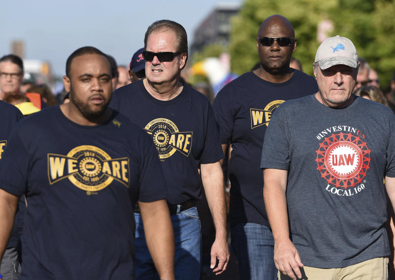 United Auto Workers President Gary Jones, center, whose home was searched by FBI agents Wednesday as part of a corruption probe, walks with UAW members during the first part of the annual Labor Day parade in downtown Detroit on Monday, Sept. 2, 2019. (Clarence Tabb Jr./Detroit News via AP)