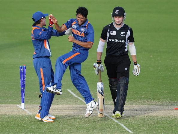 TOWNSVILLE, AUSTRALIA - AUGUST 23:  Ravikant Singh (c) and Smit Patel of India celebrates the dismissal of Connor Neynens of New Zealand during the ICC U19 Cricket World Cup 2012 Semi Final match between India and New Zealand at Tony Ireland Stadium on August 23, 2012 in Townsville, Australia.  (Photo by Ian Hitchcock/Getty Images)